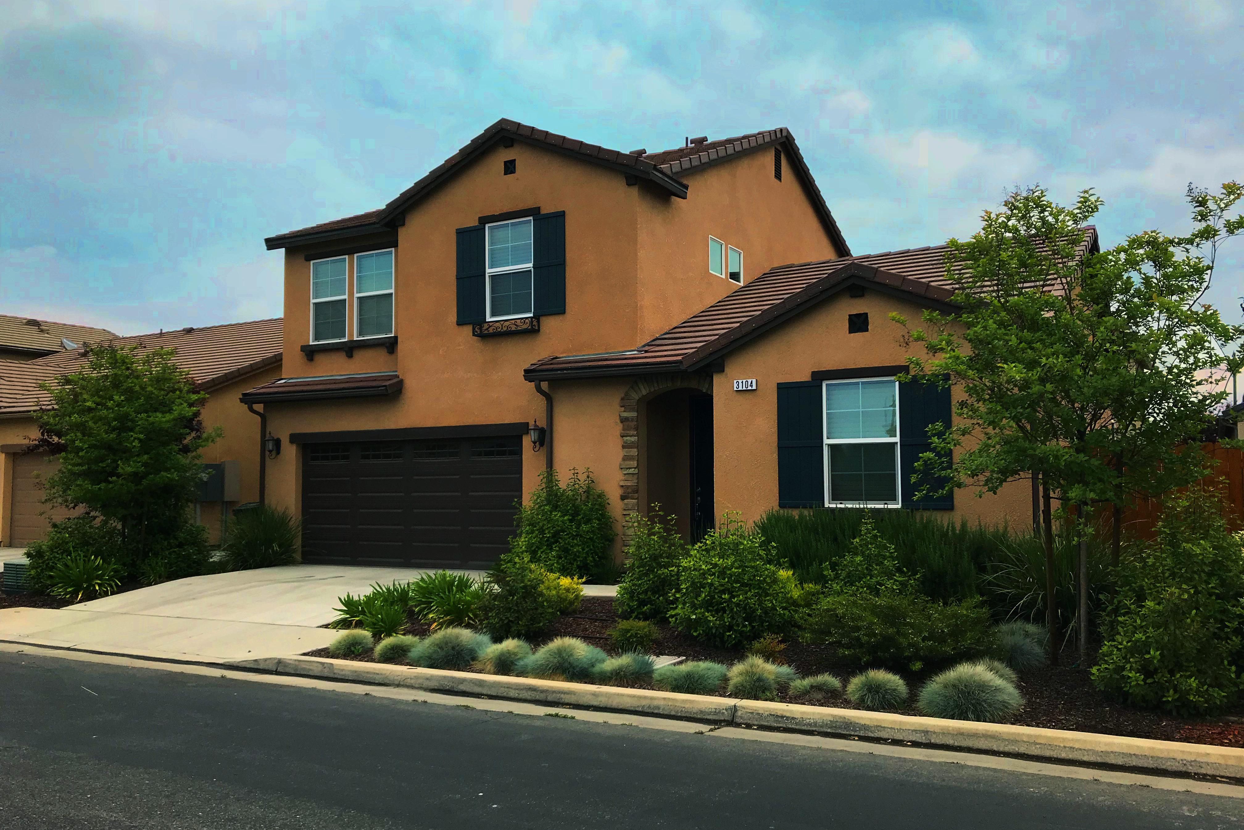 A dark brownish orange house with garage, Professional Management Services